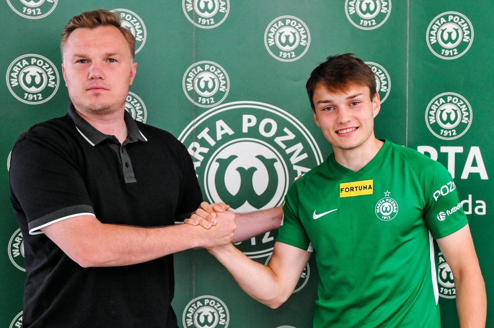Karol Gardzielewicz i dyrektor sportowy Warty Poznań Robert Graf