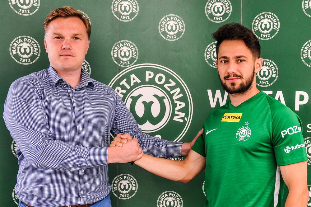 Mariusz Rybicki i dyrektor sportowy Warty Poznań Robert Graf