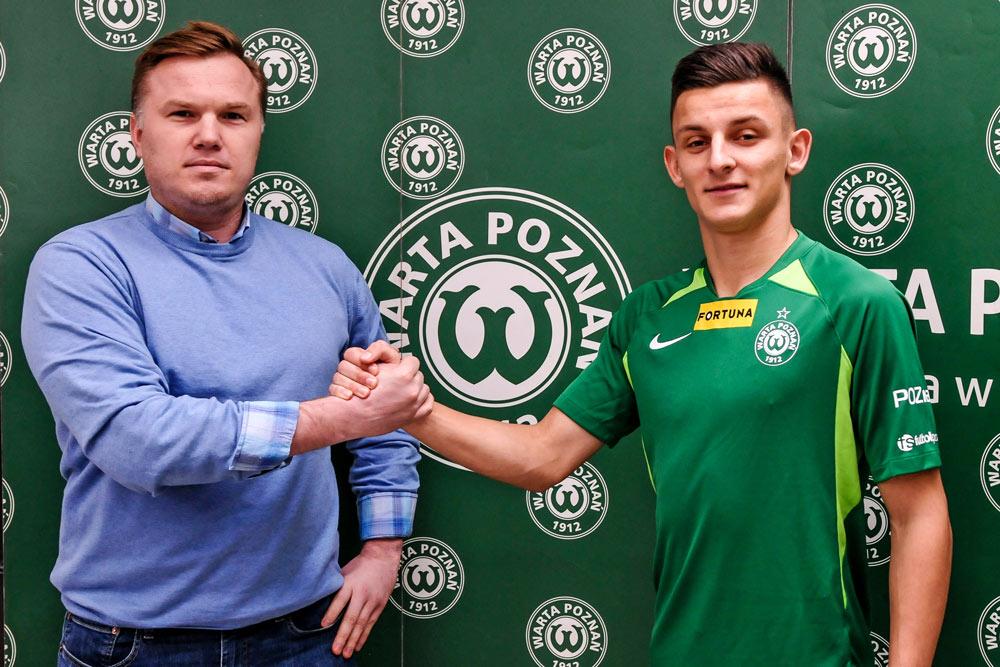 Jakub Apolinarski u dyrektor sportowy Warty Poznań Robert Graf